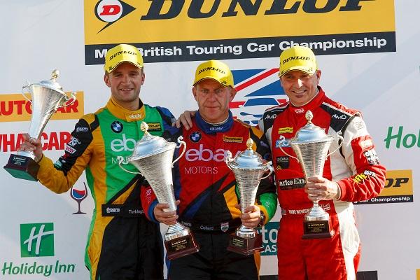 Dave Newsham on the podium with 2014 Champion Collin Turkington and Rob Collard
